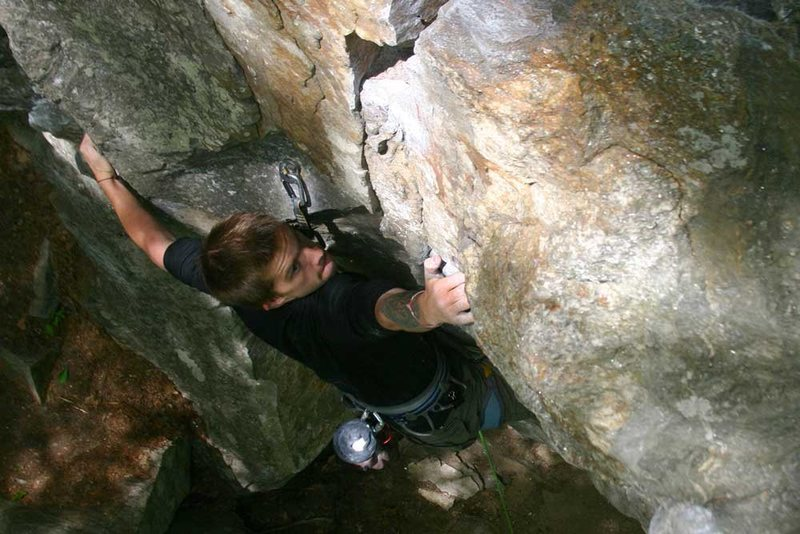 mike spanning the crux on Scene of the Crime...
