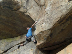 Rock Climbing Photo: Clipping the bolt before traversing into dihedral