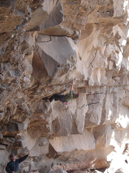 """Jay Foley working """"Letting Go"""" 12c in the Bat Cave, Vista Verde near Taos"""