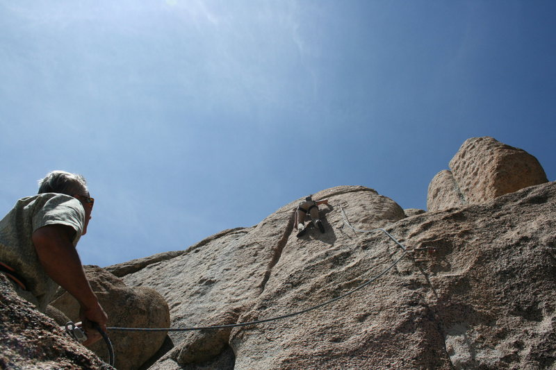 Noelle on the upper wall of a 5.10 don't know the name of with Derek on belay.<br>