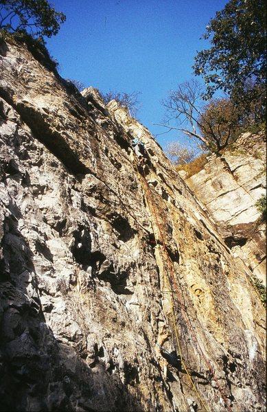 A climber high on Medusa, 5.10a