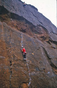 Rock Climbing Photo: A climber pauses to place gear before the crux mov...