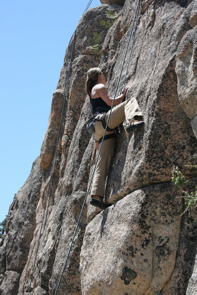 Noelle Ladd checking out the next moves after the crux.