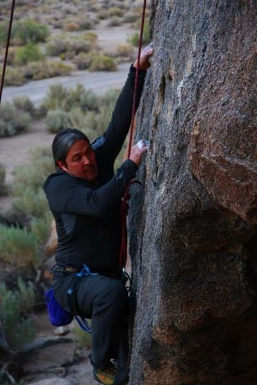 Pulling the Crux move out and over the roof to the face. Step high and right.