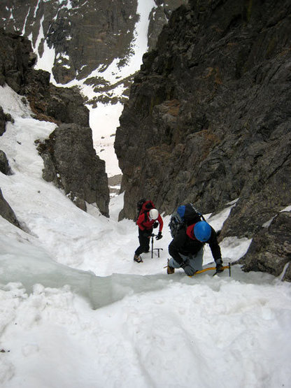 Tackling the water ice step about 1/3 of the way up the couloir.  A second tool is handy here but it's so short and easy that no protection is called for.  It may be possible to avoid the ice with some 3rd class scrambling on skiers right.