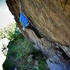 """Luke Childers climbing """"Wisdom."""""""