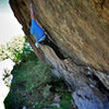 "Luke Childers on the opening moves of ""Wisdom.""  Brothers Lookout South.  Three Sisters Park, Colorado."
