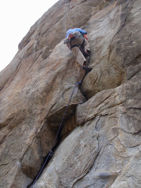 Ben on the flake leading up to the big right angling dihedral/roof