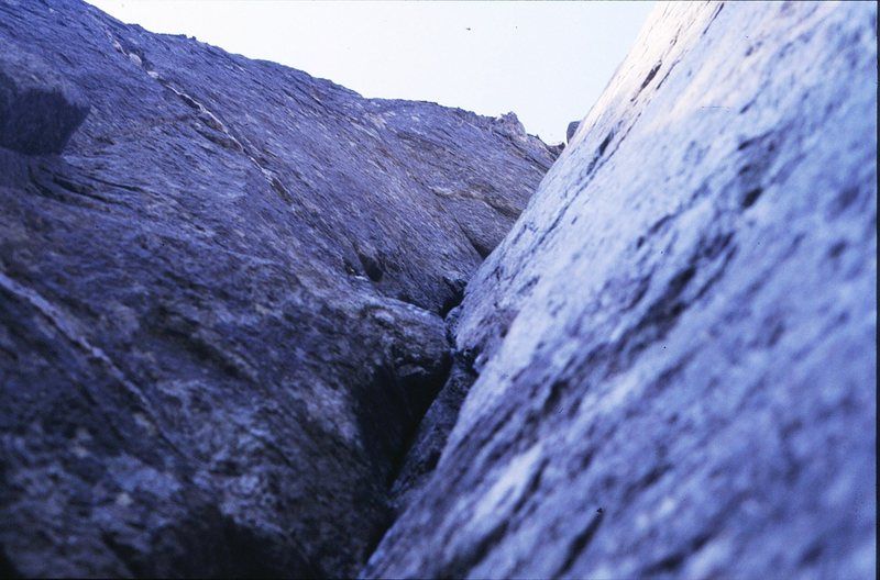 Looking up the steep corner of Left Hand Crack