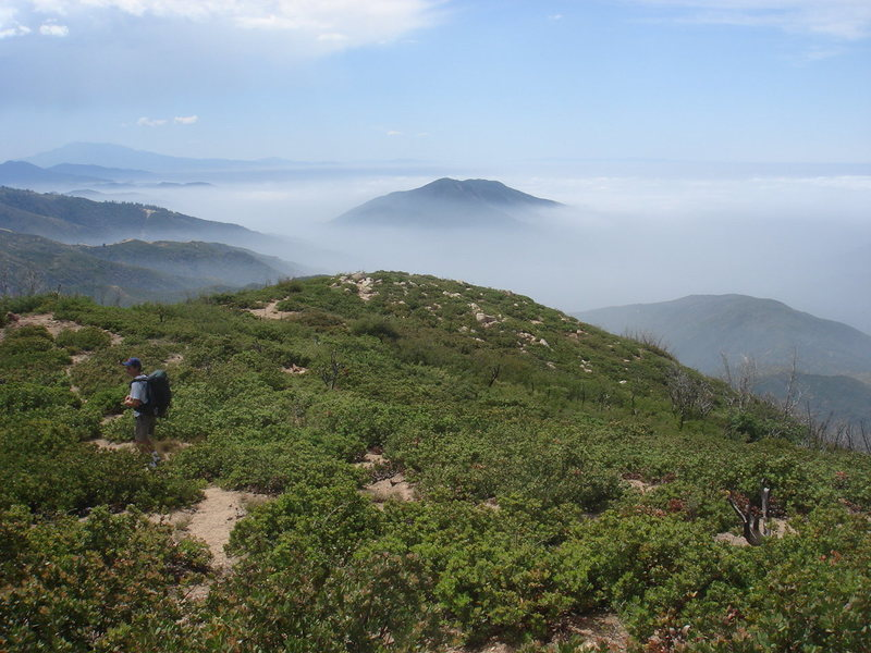 Rock Climbing Photo: The trail continues down to the rounded summit the...