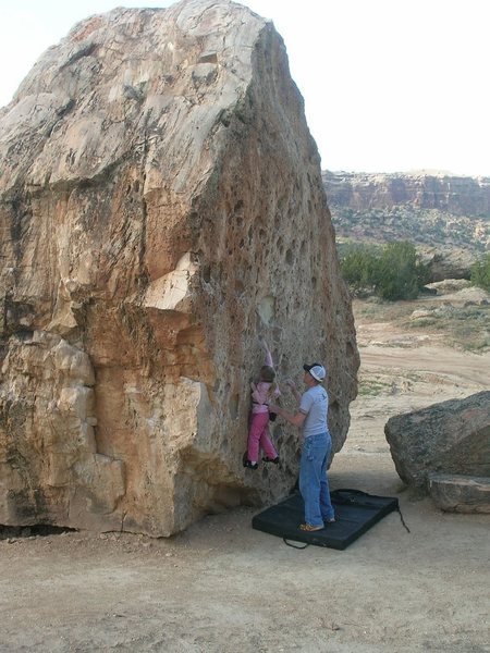 My Niece on a large boulder at Unaweep with a dinosaur fossil in the center...