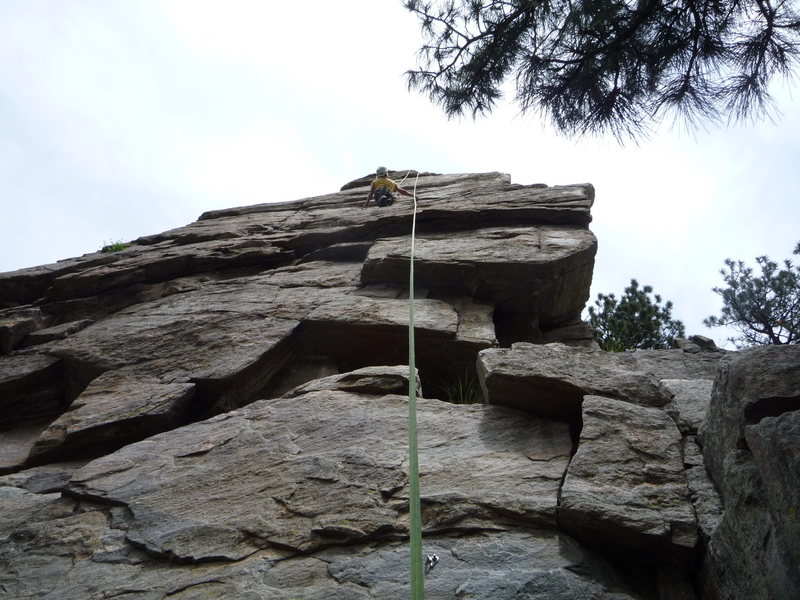 Cindy enjoying a top rope.  She is just below the crux.