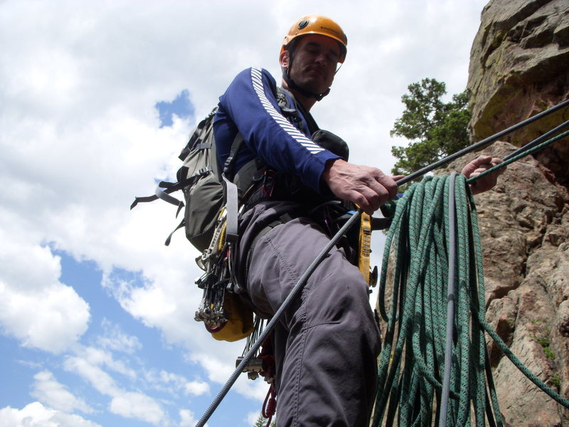 Levi the Hungarian hardman on belay, Rewritten 1st Pitch June 2009