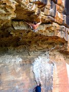 Simon Atkins cruising the 2nd ascent of Jugzilla (27 5,12d) at Thompsons Point. Nowra, NSW