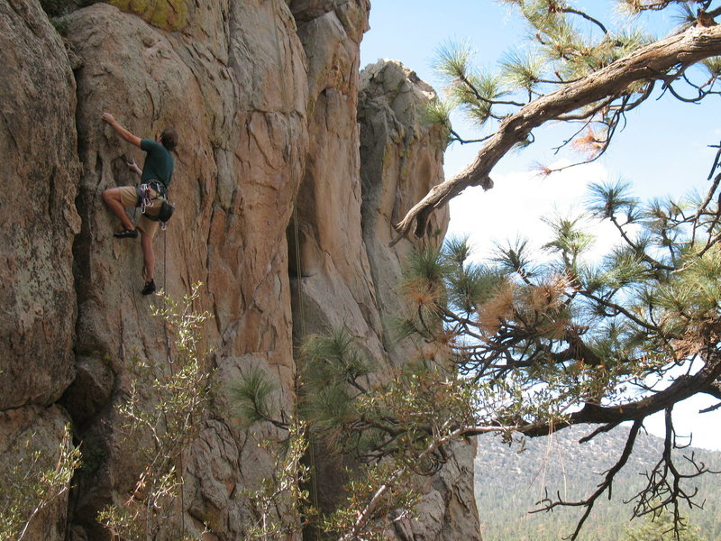 Phil on Bum Steer (5.10a), Holcomb Valley Pinnacles.<br>