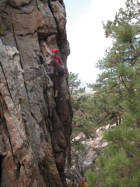 Stephanie nearing the crux of Lady Luck (5.9), Holcomb Valley Pinnacles.