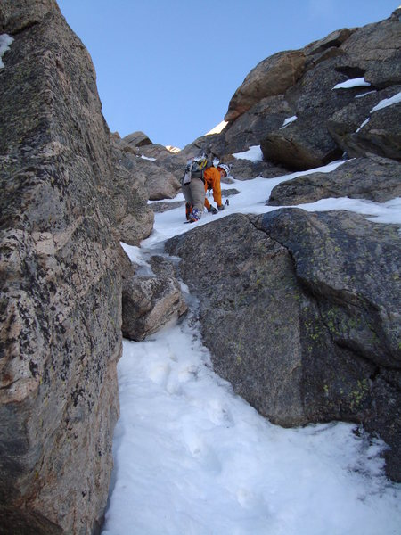 The start of the 4th class rock/snow/ice mixed section near the top of the route.