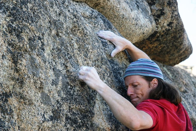 Pulling hard at the crux of Wild Abandon, 5.12a