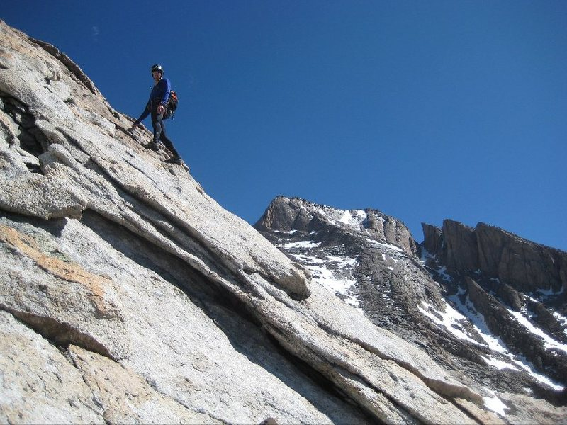 On the upper slab, with Longs Peak and Palisades in the background.  Photo by Mark Oveson.