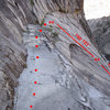 """Photo showing the """"cat walk"""" prior to the rap. It's short, easy walk to get to the rap station. First rap is 100'. Second rap is about 200'. I suspect you could do the 2nd rap at 100' and downclimb the rest on ledges to the right of the rap line. Careful not to rap off the end of your rope!"""