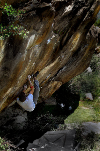 """Jason pulling tight on the bottom moves for his F.A. of """"The Razor.""""  Located at """"The Wisdom Wall.""""  The Brothers Lookout Three Sister Park, Colorado."""