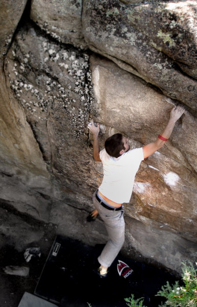 "Jason makes the hug stick on the classic problem ""Thievery.""  The Energy wall at Three Sisters Park, Colorado."