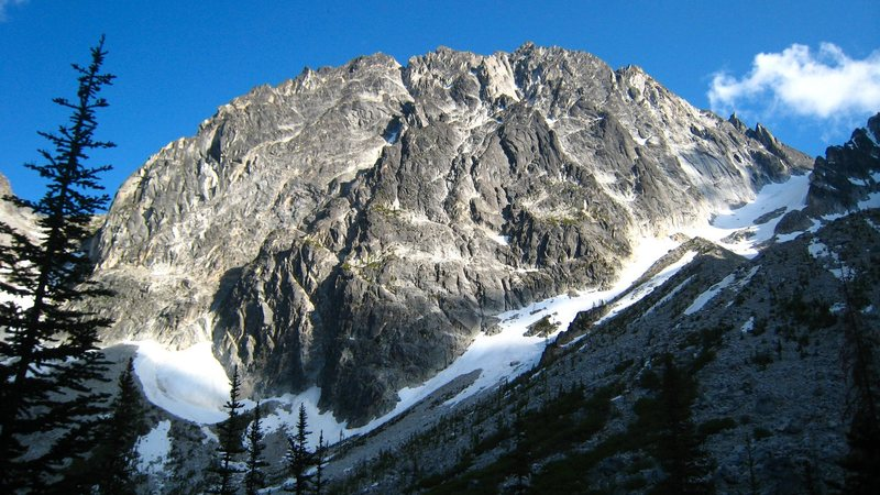 Dragontail Peak.  Backbone ridge is the lower of the 2 ridges on the right side of the face.  Serpentine Ridge is the next ridge to the right of Backbone Ridge.