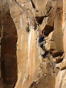 Rock Climbing Photo: JJ Schlick moving through the low roof crux.
