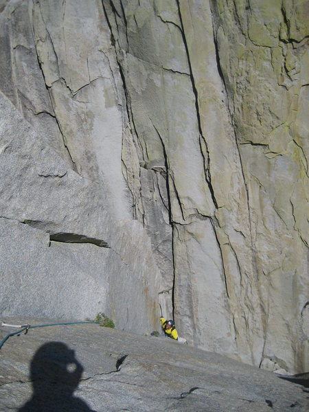 Jordi cruising the 4rth pitch, the amazing crack systems of the Witch in the background.