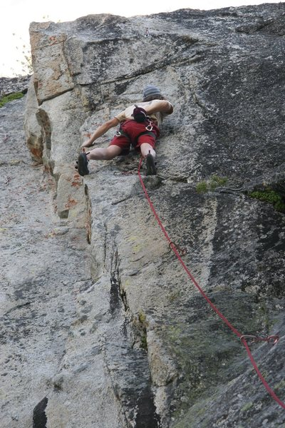 Chalking up prior to the crux on Edge of Freedom.