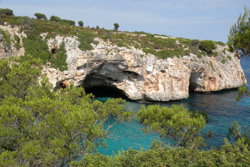 A view of the two caves that form the [[Metrosexual Area]]106481114 (left) and [[Snatch Area]]106481209 (right) at Cala Barques.