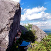 "Travis on the ""Horizon Line"" (v5), on the Horizon Boulder, Highlands Area, GHSP Va"