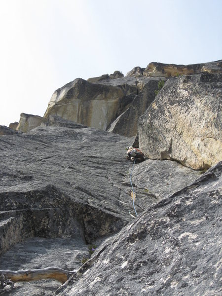 Climbing the left facing corner on pitch 3.  The preferred start is to climb the flake on the left that meets up with the corner.