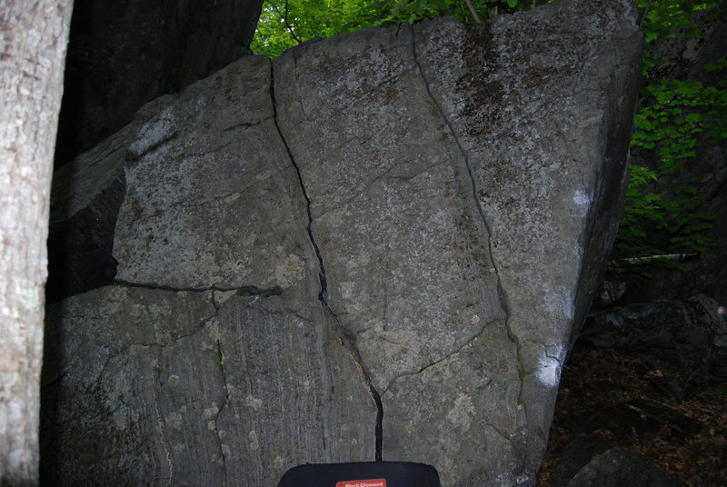 These cracks make up The Long Trail (V0)<br> <br> PBR (V4) climbs the right arete and the hidden face around right of the arete