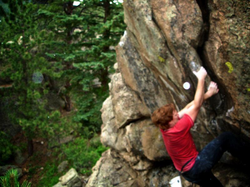 """Luke Childers climbing """"Brain Child."""""""
