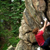 "Luke Childers climbing ""Brain Child."""