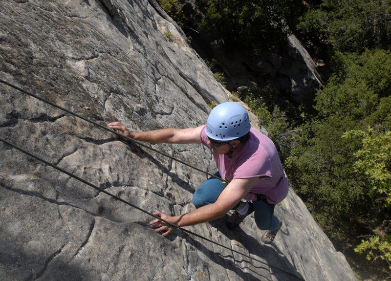 Scott encounters delicate slab climbing near the top of Applied Magnetics, at San Ysidro