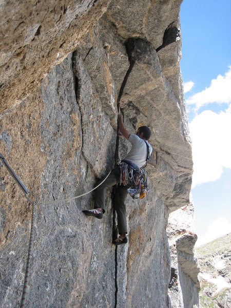 Rob Kepley sets up for the burly roof crux.