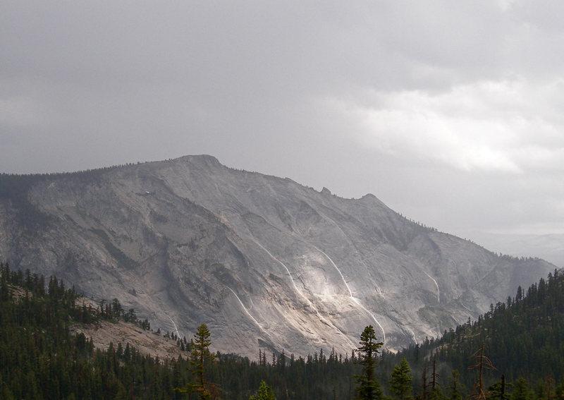 Rainwater cascades down Cloud's Rest during a summer storm