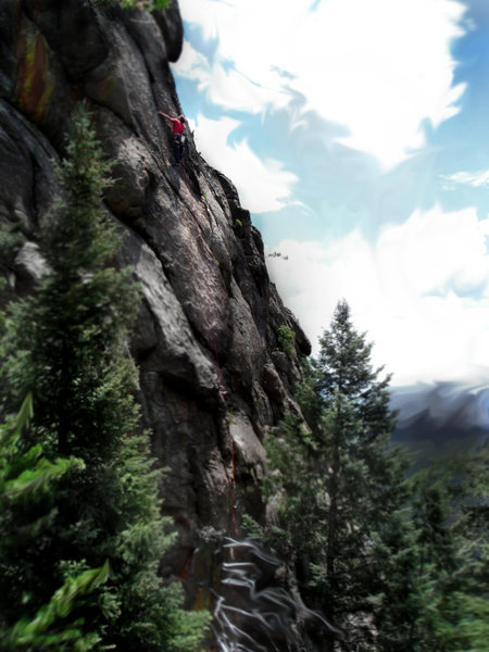 "Luke Childers climbing the supper cool upper head wall section of ""Head For Backstage Pass.""  Devil's Head, Colorado."