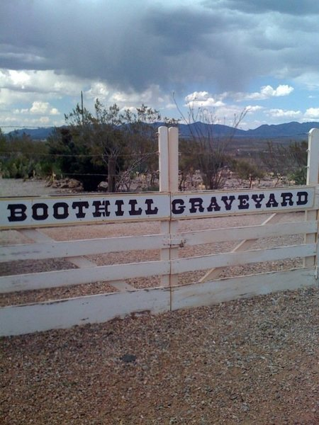 Boothill Graveyard, Tombstone AZ.  The Dragoon Mountains, home to Cochise Stronghold, are in the background.