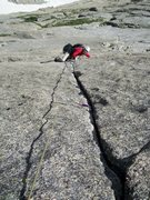 Rock Climbing Photo: Joe following the 220ft crux pitch on the Barb...