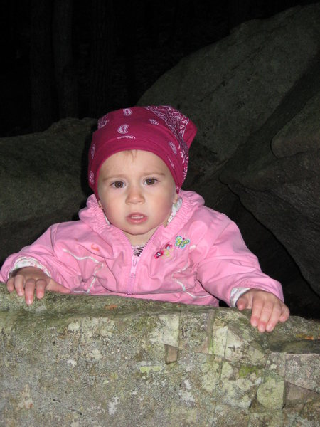 My daughter Mackenzie finally getting to the top of her first route.
