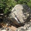 Pissoir Boulder, Skofield Park<br> Orange: Fertloaf (V0)<br> Red: Dung Buddy (V0+)