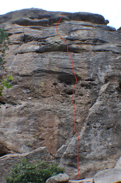 Start at the base of the right angling ledge and climb straight up through a large pocket (crux) and finish with three sloping ledges.