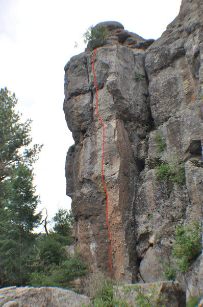 Climb the left-facing corner to a face. Left of the big arch.