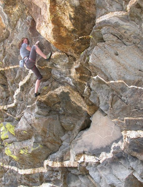 Climbing the cool rock of the lower section of Oedipus.