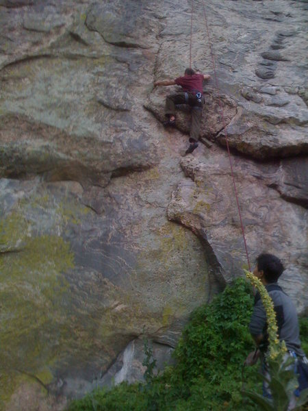 Jay belaying T. Ward on the new slab route two right of Crack a Beer