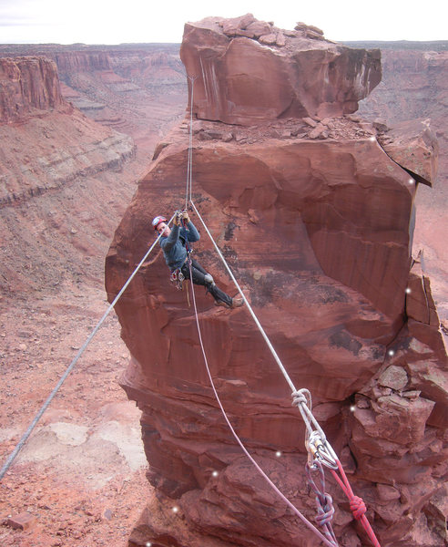 A vertical pano of Sam on his way back to the rim with the upper part of the second pitch marked.<br> <br> <b>TREAD VERY LIGHTLY</b> on that block near the top! <br> <br> I would have given this route two stars if it had not been for that block.