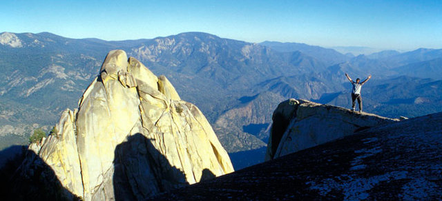 Rock Climbing Photo: Matt Grieger stands atop the Charlatan (the Needle...